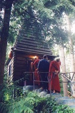 Monks visiting the flaming stupa built by Jerry Wennstrom